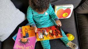 toddler reading books she loves