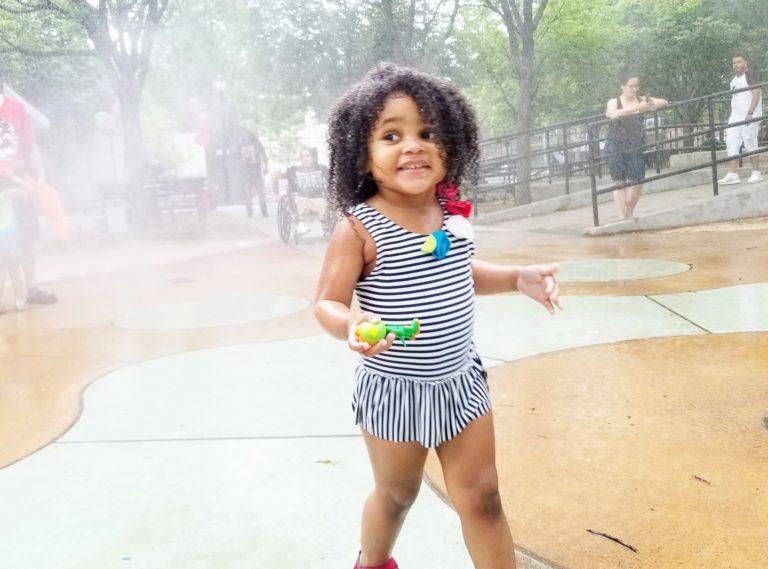 NYC public park summer sprinkler